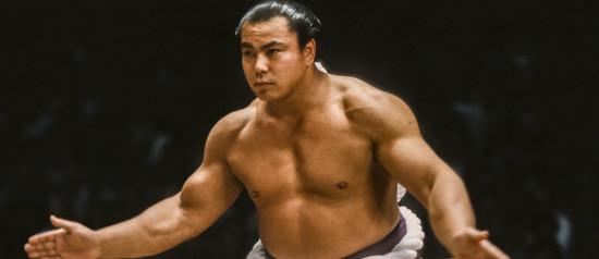 FUKUOKA, JAPAN - NOV 1983:  Chiyonofuji Mitsugu, born as Akimoto Mitsugu, appears in a ceremony before a match during the 1983 Kyushu Basho sumo wrestling tournament held in November 1983 at the Fukuoka Kokusai Center in Fukuoka, Japan.  (Photo by David Madison/Getty Images)